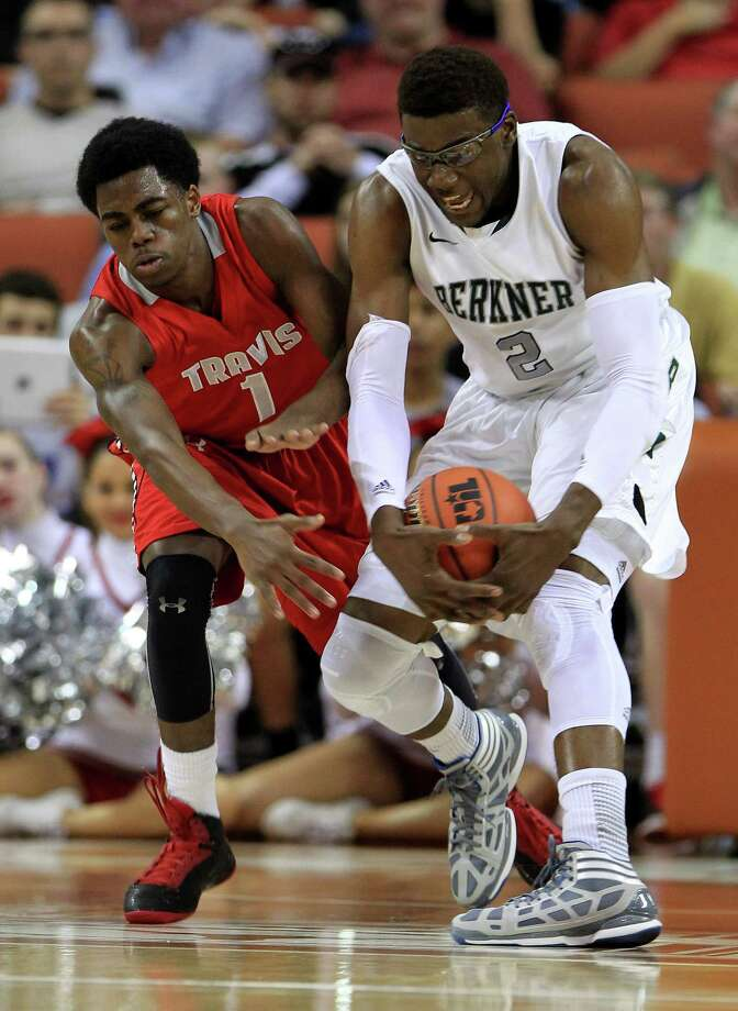 Berkner's Soma Edo (2) tries to get his hands on the rebound against Travis' John Burnett (1) during the first half. Photo: Karen Warren, Houston Chronicle / © 2013 Houston Chronicle