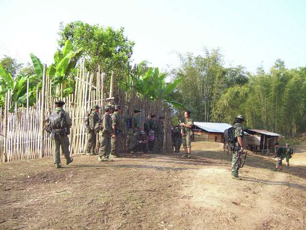 Soldiers patrol a refugee camp along the Myanmar-Thailand border where Steah Htoo and her family lived for 20 years in rough conditions. (Photo courtesy of Steah Htoo)