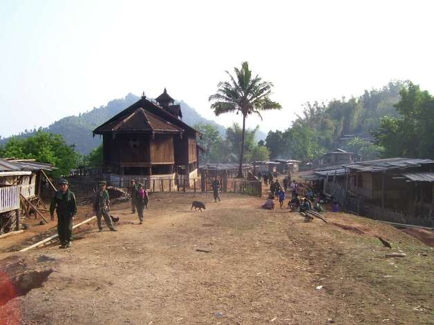 Soldiers patrol a refugee camp along the Myanmar-Thailand border where Steah Htoo and her family lived for 20 years in rough conditions. (Photo courtesy Steah Htoo)