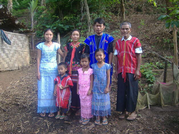 Steah Htoo, shown with her husband and three children and her parents in their finest traditional Karenni clothing at the refugee camp along the Myanmar-Thailand border. (Photo courtesy Steah Htoo)