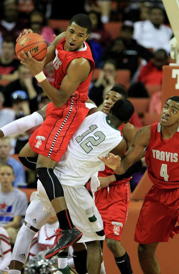 Travis Andrew Harrison (5) sits on top of Berkner's Keenan Evans (12) after grabbing the rebound during the first half. Photo: Karen Warren, Houston Chronicle / © 2013 Houston Chronicle