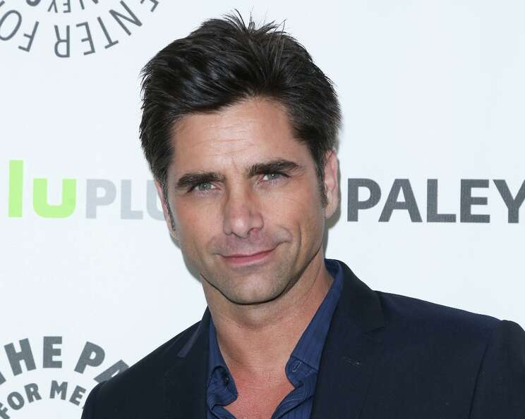 Actor John Stamos attends the 30th annual PaleyFest featuring the cast of The New Normal at Saban Th