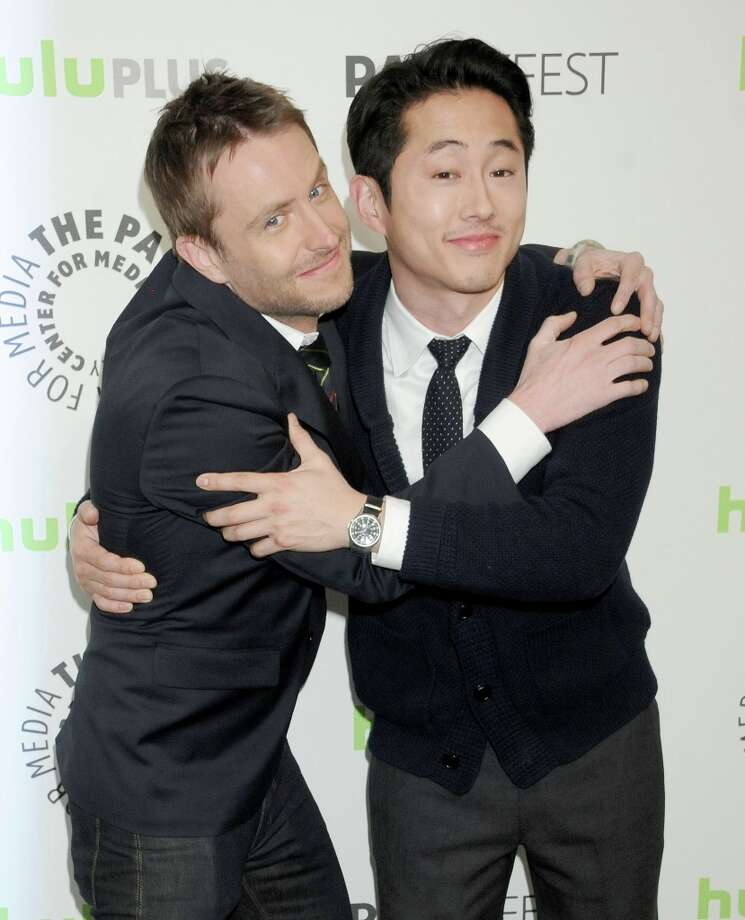 Actors Chris Hardwick and Steven Yeun arrive at the 30th Annual PaleyFest: The William S. Paley Television Festival featuring 'The Walking Dead' at Saban Theatre on March 1, 2013 in Beverly Hills, California. Photo: Gregg DeGuire, WireImage / 2013 Gregg DeGuire