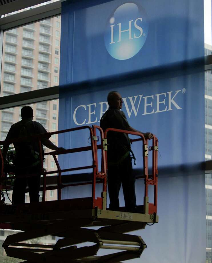 Workers begin to remove banners for the IHS CERAWeek conference. The international assembly of policymakers, corporate leaders and energy experts concluded Friday at the Hilton Americas-Houston downtown. Photo: Melissa Phillip, Staff / © 2013  Houston Chronicle