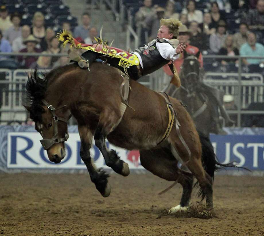 Wes Stevenson of Lubbock hangs on to complete his ride in the third round of the Super Series IV bareback riding competition at RodeoHouston on Friday night. Stevenson scored an 85.5 to win the round and the aggregate title along with a spot in next week's semifinals. Photo: James Nielsen, Staff / © 2013  Houston Chronicle