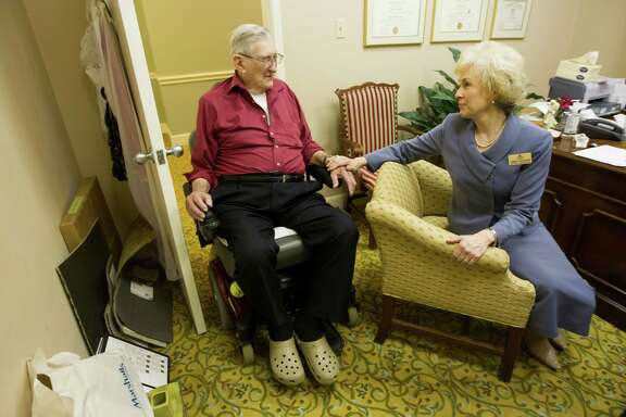 George  McMahan,  97, visits with Cindy Jackson,  administrator of health services  at the Clarewood House. McMahan  has signed  a do-not-resuscitate order because he believes that due to his age his quality of life would  diminish.