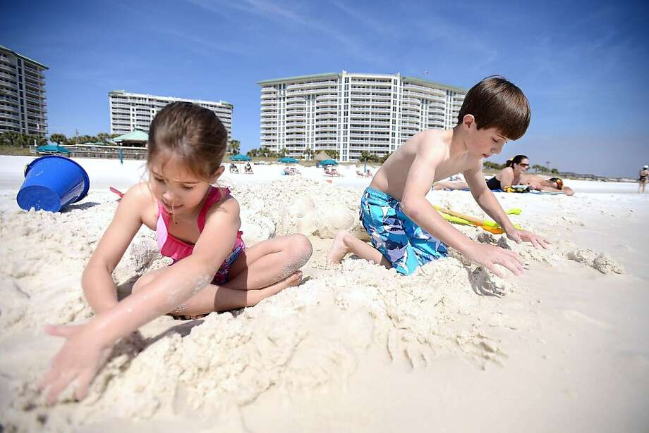 Danielle Labbe', 6, left, and her brother Jean-Paul Labbe', 9, play in the sand on Friday March 8, 2013 in Destin, Florida. The Travel Channel named Destin the Best Family Beach of 2013. (AP Photo/Northwest Florida Daily News, Nick Tomecek) Photo: Nick Tomecek, Associated Press