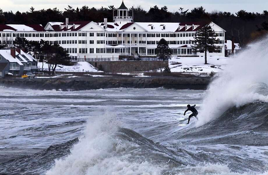 "Benny Nadeau of Moody Beach, Maine, rides a large wave in heavy surf kicked up by a winter storm Friday afternoon, March 8, 2013, in Kennebunk, Maine. ""It's craziness,"" said Nadeau after his ride. ""I was little scared."" (AP Photo/Robert F. Bukaty) Photo: Robert F. Bukaty, Associated Press"