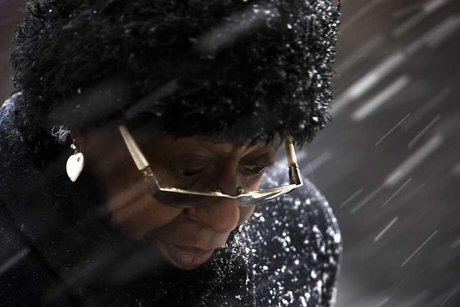 A woman crosses Market Street during a winter snow storm Friday, March 8, 2013, in Philadelphia. Many areas in the state reported 4 to 6 inches of snow. (AP Photo/Matt Rourke) Photo: Matt Rourke, Associated Press