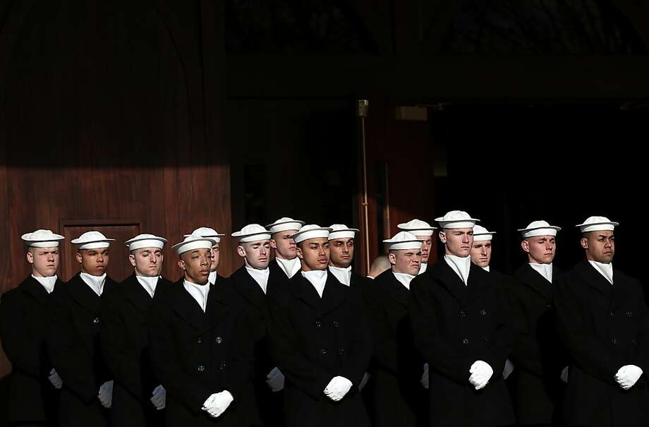 ARLINGTON, VA - MARCH 08:  U.S. Navy ceremonial team members await the beginning of a funeral service at Arlington National Cemetery for two unknown sailors who were killed in 1862 when the Civil War era USS Monitor sank off the coast of North Carolina March 8, 2013 in Arlington, Virgiina. The sailors' remains, recovered when a portion of the ship was raised eleven years ago, were buried with full military honors.  (Photo by Win McNamee/Getty Images) Photo: Win McNamee, Getty Images