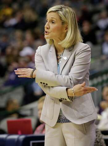 Texas coach Karen Aston talks to her players during the first half of NCAA college basketball game against Kansas State at the Big 12 women's tournament Friday, March 8, 2013, in Dallas. (AP Photo/Tony Gutierrez) Photo: Tony Gutierrez, Associated Press / AP