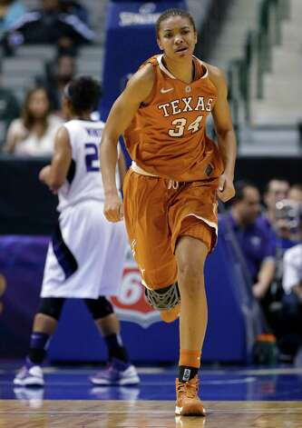 Texas' Imani McGee-Stafford runs up the court during the first half of an NCAA college basketball game against Kansas State in the Big 12 women's tournament Friday, March 8, 2013, in Dallas. (AP Photo/Tony Gutierrez) Photo: Tony Gutierrez, Associated Press / AP