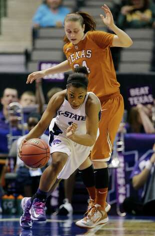 Kansas State's Haley Texada (1) steals the ball in front of Texas' Chassidy Fussell (24) during the first half of an NCAA college basketball game in the Big 12 women's tournament Friday, March 8, 2013, in Dallas. (AP Photo/Tony Gutierrez) Photo: Tony Gutierrez, Associated Press / AP