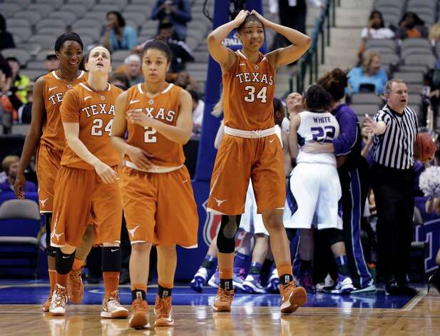 Texas' Chassidy Fussell (24), Nneka Enemkpali, Celina Rodrigo (2) and Imani McGee-Stafford (34) walk off as Kansas State celebrates the win in an NCAA college basketball game in the Big 12 women's tournament Friday, March 8, 2013, in Dallas. Kansas State defeated Texas 51-49. (AP Photo/Tony Gutierrez) Photo: Tony Gutierrez, Associated Press / AP