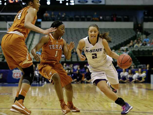 Kansas State's Brittany Chambers (2) drives around Texas' Empress Davenport (1) and Imani McGee-Stafford (34) during the first half of an NCAA college basketball game in the Big 12 women's tournament Friday, March 8, 2013, in Dallas. (AP Photo/Tony Gutierrez) Photo: Tony Gutierrez, Associated Press / AP