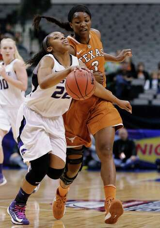 Kansas State guard Mariah White (22) drives against Texas' Nneka Enemkpali (3) during the first half of an NCAA college basketball game in the Big 12 women's tournament Friday, March 8, 2013, in Dallas. (AP Photo/Tony Gutierrez) Photo: Tony Gutierrez, Associated Press / AP
