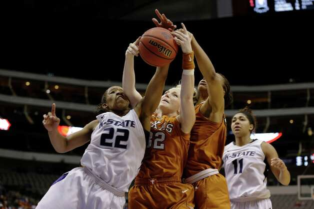 Kansas State' Mariah White (22) gets an elbow to the face as she competes for a rebound against Texas 's Brady Sanders (32) and Imani McGee-Stafford, second from right, in the second half of an NCAA college basketball game in the Big 12 women's tournament Friday, March 8, 2013, in Dallas. Kansas State won 51-49. (AP Photo/Tony Gutierrez) Photo: Tony Gutierrez, Associated Press / AP