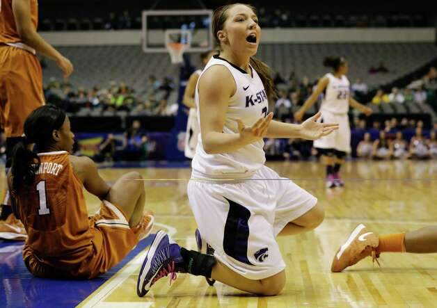 Kansas State 's Brittany Chambers (2) reacts after scrambling on the floor against Texas 's Nneka Enemkpali for a loose ball in the first half of an NCAA college basketball game in the Big 12 women's tournament Friday, March 8, 2013, in Dallas. Kansas State won 51-49. (AP Photo/Tony Gutierrez) Photo: Tony Gutierrez, Associated Press / AP