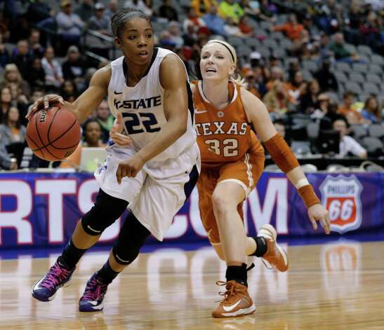 Kansas State's Mariah White (22) drives past Texas' Brady Sanders (32) during the first half of an NCAA college basketball game in the Big 12 women's tournament Friday, March 8, 2013, in Dallas. (AP Photo/Tony Gutierrez) Photo: Tony Gutierrez, Associated Press / AP