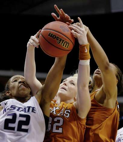 Kansas State's Mariah White (22) gets an elbow to the face as she competes for a rebound against Texas' Brady Sanders (32) and Imani McGee-Stafford, right, in the second half of an NCAA college basketball game in the Big 12 women's tournament Friday, March 8, 2013, in Dallas. Kansas State won 51-49. (AP Photo/Tony Gutierrez) Photo: Tony Gutierrez, Associated Press / AP