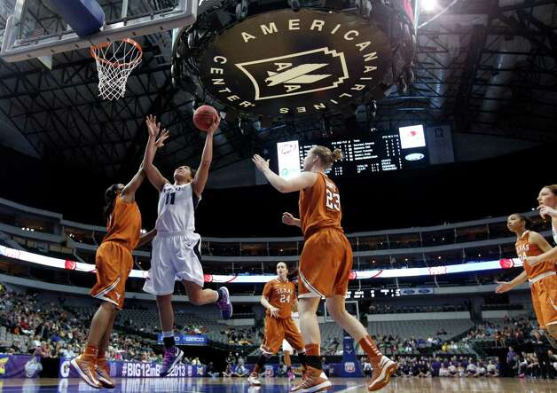 Texas' Empress Davenport, left, and Gigi Mazionyte (23) defend as Kansas State's Chantay Caron (11) shoots during the first half of an NCAA college basketball game in the Big 12 women's tournament Friday, March 8, 2013, in Dallas. (AP Photo/Tony Gutierrez) Photo: Tony Gutierrez, Associated Press / AP