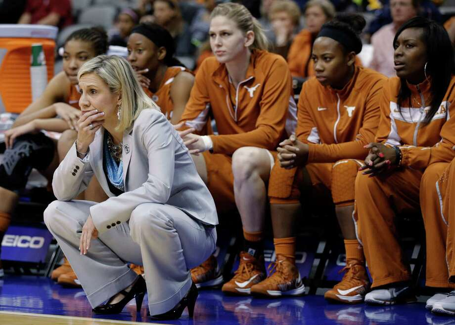 Texas coach Karen Aston and players on the bench watch in the final seconds of an NCAA college basketball game against Kansas State in the Big 12 women's tournament, Friday, March 8, 2013, in Dallas. Kansas State won 51-49. (AP Photo/Tony Gutierrez) Photo: Tony Gutierrez, Associated Press / AP