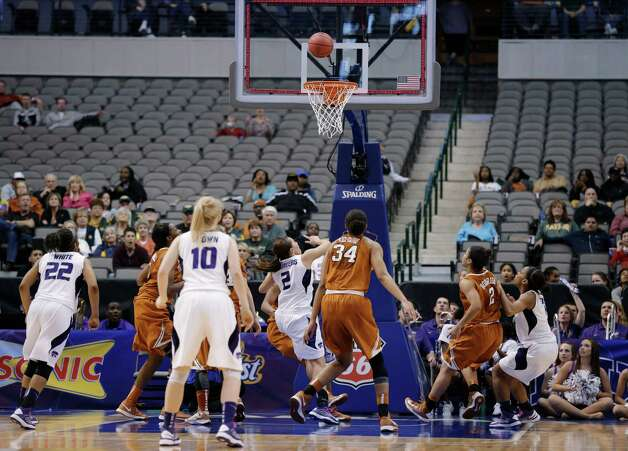 Kansas' Brittany Chambers (2) looks up at her shot at the final buzzer in an NCAA college basketball game against Texas in the Big 12 women's tournament Friday, March 8, 2013, in Dallas. Kansas State won 51-49. (AP Photo/Tony Gutierrez) Photo: Tony Gutierrez, Associated Press / AP