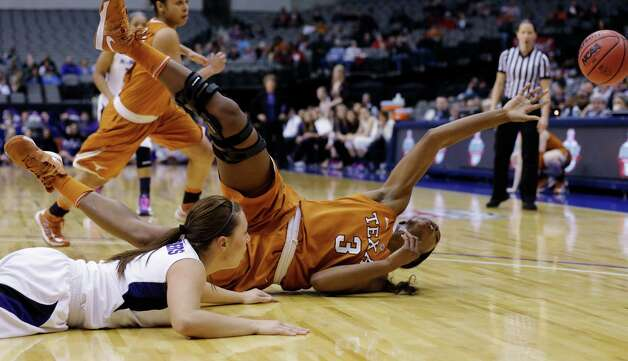 Kansas State guard Brittany Chambers, left, watches as Texas' Nneka Enemkpali (3) reaches out for a loose ball as the duo scramble on the floor during the first half of NCAA college basketball game in the Big 12 women's tournament Friday, March 8, 2013, in Dallas. (AP Photo/Tony Gutierrez) Photo: Tony Gutierrez, Associated Press / AP