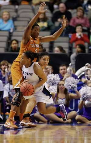 Kansas State' Haley Texada (1) collides with Texas 's Nneka Enemkpali (3) on a drive to the basket in the second half of an NCAA college basketball game in the Big 12 women's tournament Friday, March 8, 2013, in Dallas. Kansas State won 51-49. (AP Photo/Tony Gutierrez) Photo: Tony Gutierrez, Associated Press / AP