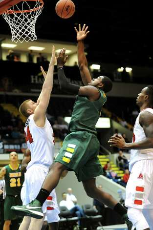 Siena's O.D. Anosike (1), right, shoots for the hoop as Marist's Pieter Prinsloo (34) defends during their first round MAAC Championship basketball game on Friday, March 8, 2013, at MassMutual Center in Springfield, Mass. (Cindy Schultz / Times Union) Photo: Cindy Schultz / 10021490A