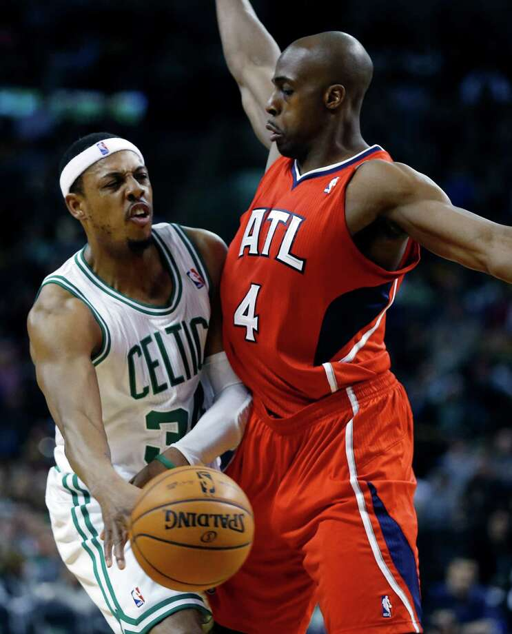 Boston Celtics' Paul Pierce, left, passes as Atlanta Hawks' Anthony Tolliver (4) defends during the first quarter of an NBA basketball game in Boston, Friday, March 8, 2013. (AP Photo/Michael Dwyer) Photo: Michael Dwyer