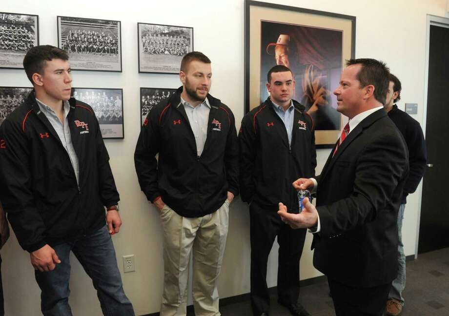 New RPI head football coach Ralph Isernia, right, talks with players on Friday March 8, 2013 in Troy, N.Y. (Michael P. Farrell/Times Union) Photo: Michael P. Farrell
