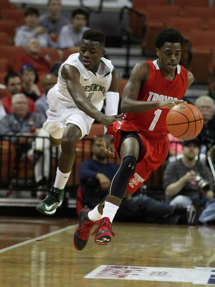 Travis' John Burnett (1) is fouled by Berkner's Joshua Francis (1) during the second half. Photo: Karen Warren, Houston Chronicle / © 2013 Houston Chronicle