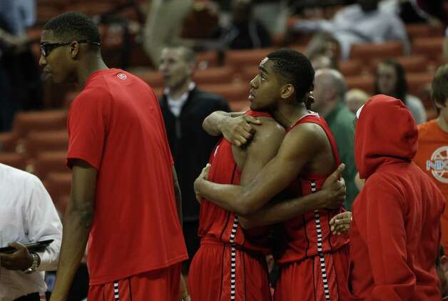 Members of the Fort Bend Travis team hug after their win over Richardson Berkner. Photo: Karen Warren, Houston Chronicle / © 2013 Houston Chronicle