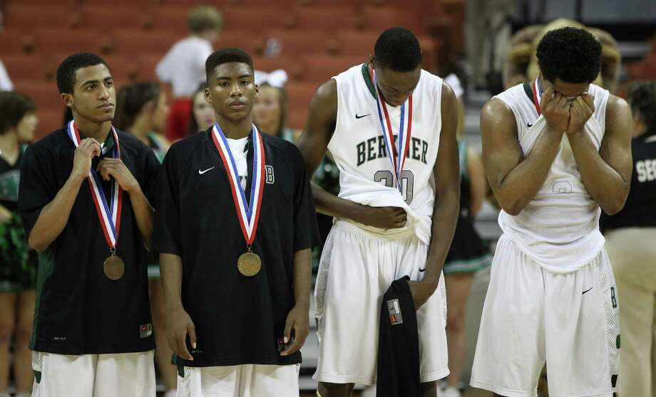 Members of the Richardson Berkner team react after losing to Fort Bend Travis after the UIL 5A boys state basketball semifinal game between Fort Bend Travis and Richardson Berkner at the Frank Erwin Center, Friday, March 8, 2013, in Austin. Travis won the game sending them to the finals, Saturday against South Grand Prairie. Photo: Karen Warren, Houston Chronicle / © 2013 Houston Chronicle