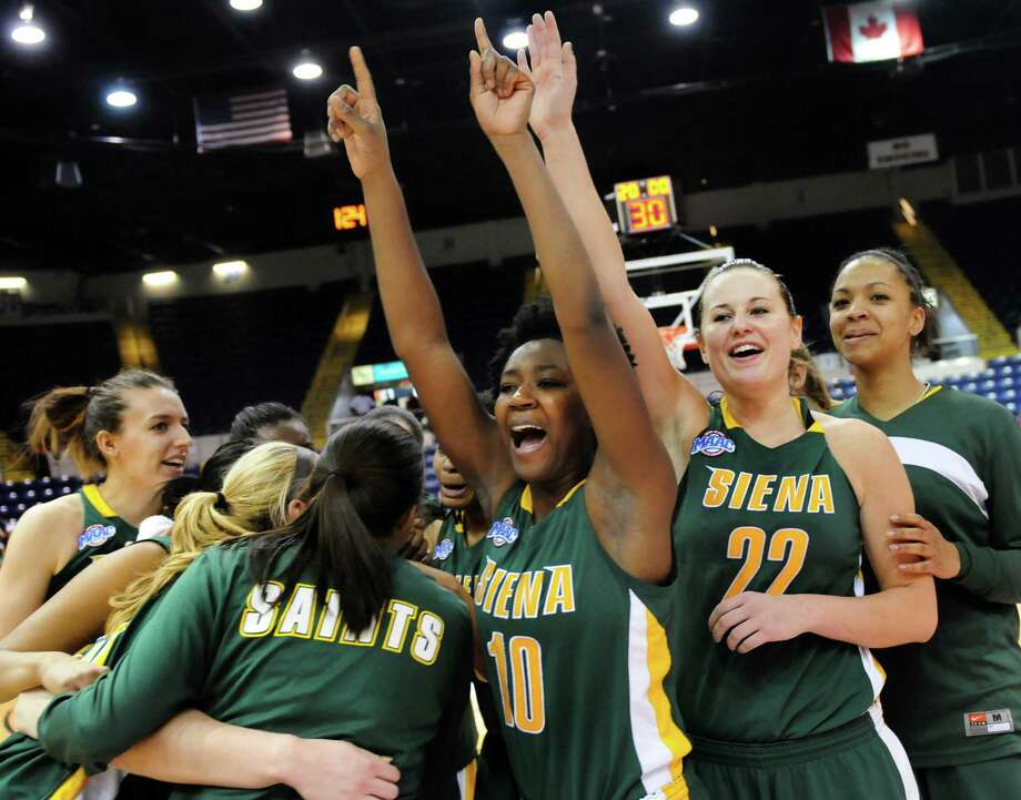 Siena's Allison Mullings (10), center, and Lily Grenci (22), right, celebrate with their team when they win 52-48 over Fairfield in their quarterfinal MAAC Championship basketball game on Friday, March 8, 2013, in Springfield, Mass. (Cindy Schultz / Times Union) Photo: Cindy Schultz / 10021489A