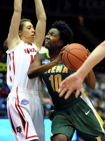 Siena's Allison Mullings (10), right, goes for the hoop as Fairfield's Katelyn Linney (12) defends during their quarterfinal MAAC Championship basketball game on Friday, March 8, 2013, in Springfield, Mass. (Cindy Schultz / Times Union) Photo: Cindy Schultz / 10021489A