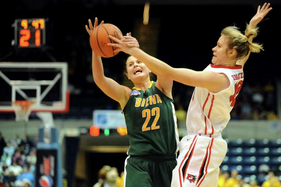 Siena's Lily Grenci (22), left, struggles to keep the ball against Fairfield's Kristin Schatzlein (40) during their quarterfinal MAAC Championship basketball game on Friday, March 8, 2013, in Springfield, Mass. (Cindy Schultz / Times Union) Photo: Cindy Schultz / 10021489A