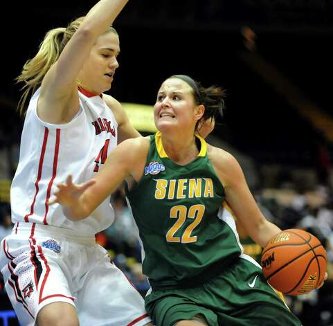 Siena's Lily Grenci (22), right, drives the ball past Fairfield's Katie Cizynski (44) during their quarterfinal MAAC Championship basketball game on Friday, March 8, 2013, in Springfield, Mass. (Cindy Schultz / Times Union) Photo: Cindy Schultz / 10021489A