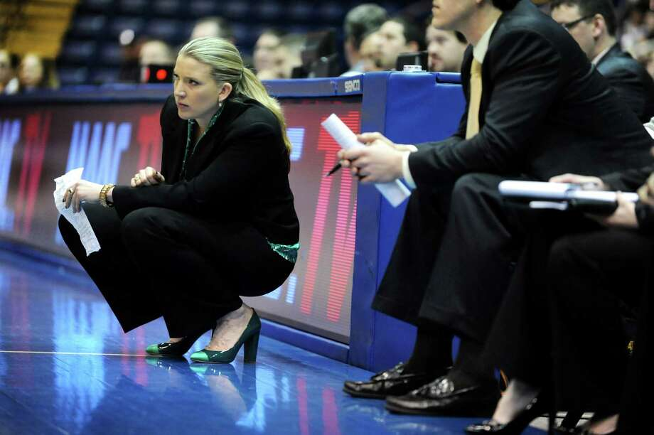 Siena's coach Ali Jaques is fashion forward with her matching green heels during their quarterfinal MAAC Championship basketball game against Fairfield on Friday, March 8, 2013, in Springfield, Mass. (Cindy Schultz / Times Union) Photo: Cindy Schultz / 10021489A