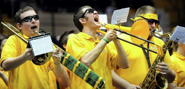 Siena Pep Band members Brian Christofel, 18, left, Adam Nelson, 19, center, and Cody Unczur, 21, perform during the women's quarterfinal MAAC Championship basketball game against Fairfield on Friday, March 8, 2013, in Springfield, Mass. (Cindy Schultz / Times Union) Photo: Cindy Schultz / 10021489A
