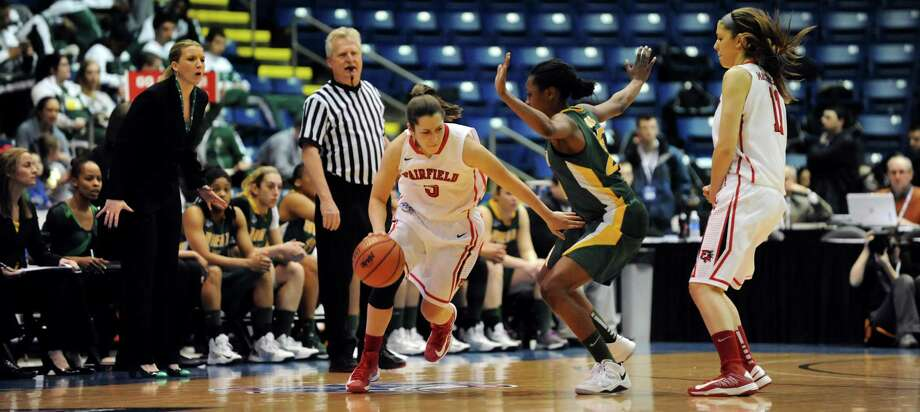 Fairfield's Felicia DaCruz (5), left, drives past Siena's Tehresa Coles (25) during their quarterfinal MAAC Championship basketball game on Friday, March 8, 2013, in Springfield, Mass. (Cindy Schultz / Times Union) Photo: Cindy Schultz / 10021489A