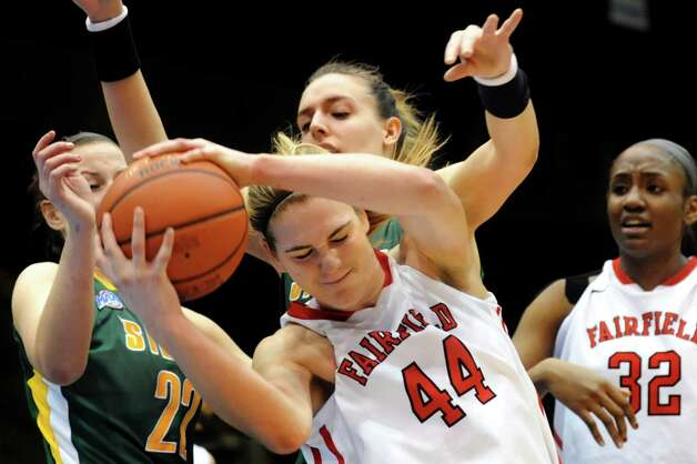 Fairfield's Katie Cizynski (44), center, grabs the rebound during their quarterfinal MAAC Championship basketball game against Siena on Friday, March 8, 2013, in Springfield, Mass. (Cindy Schultz / Times Union) Photo: Cindy Schultz / 10021489A