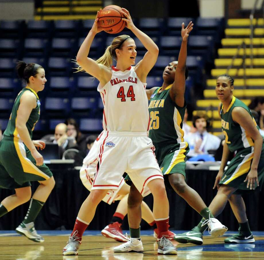 Fairfield's Katie Cizynski (44), center, looks to pass as Siena's Tehresa Coles (25) defends during their quarterfinal MAAC Championship basketball game on Friday, March 8, 2013, in Springfield, Mass. (Cindy Schultz / Times Union) Photo: Cindy Schultz / 10021489A