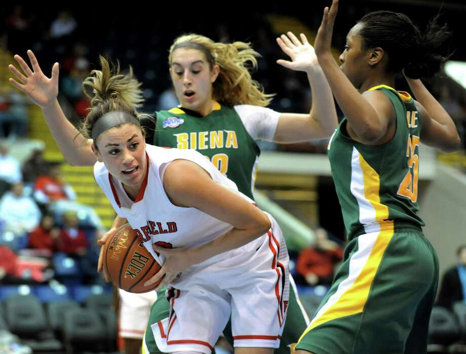 Fairfield's Alexys Vazquez (13), left, grabs the rebound as Siena's Kate Zarotney (23), center, and Tehresa Coles (25) defend during their quarterfinal MAAC Championship basketball game on Friday, March 8, 2013, in Springfield, Mass. (Cindy Schultz / Times Union) Photo: Cindy Schultz / 10021489A