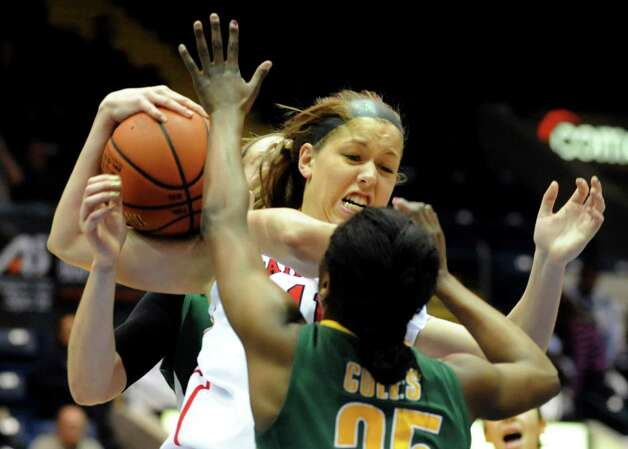 Fairfield's Brittany MacFarlane (11), left, wins the rebound as Siena's Tehresa Coles (25) defends during their quarterfinal MAAC Championship basketball game on Friday, March 8, 2013, in Springfield, Mass. (Cindy Schultz / Times Union) Photo: Cindy Schultz / 10021489A