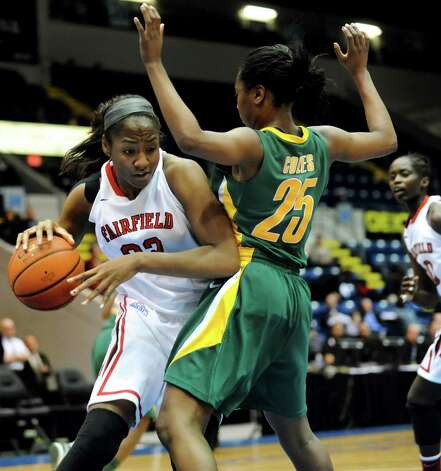 Fairfield's Brittany Obi-Tabot (32), left, drives past Siena's Tehresa Coles (25) during their quarterfinal MAAC Championship basketball game on Friday, March 8, 2013, in Springfield, Mass. (Cindy Schultz / Times Union) Photo: Cindy Schultz / 10021489A