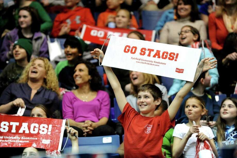 Fairfield fans react as they watch the Kiss Cam during a break in the quarterfinal MAAC Championship basketball game against Siena on Friday, March 8, 2013, in Springfield, Mass. (Cindy Schultz / Times Union) Photo: Cindy Schultz / 10021489A