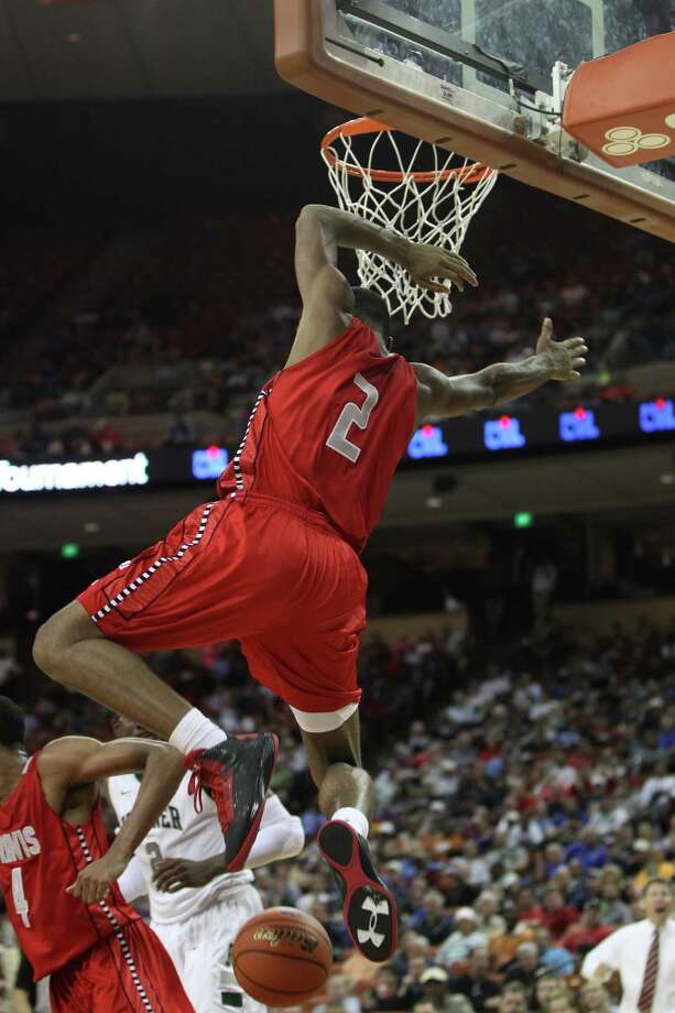 Travis' Aaron Harrison (2) jumps down off the basket after a basket during the second half. Photo: Karen Warren, Houston Chronicle / © 2013 Houston Chronicle