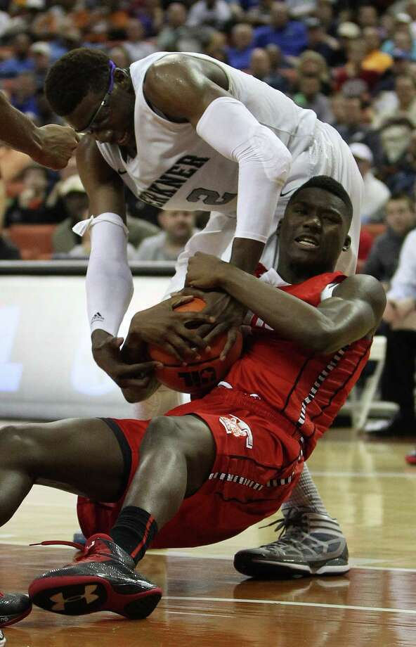 Berkner's Soma Edo (2) knocks Travis' Juwan Williams (32) to the ground as they battled under the basket. Photo: Karen Warren, Houston Chronicle / © 2013 Houston Chronicle